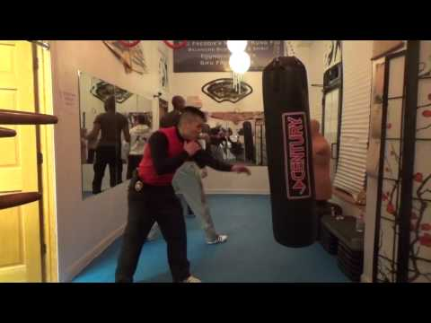 Straight Blast Punch Training on Heavy Bag Image 1