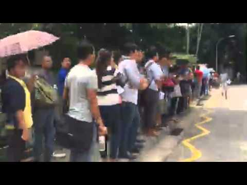 Voters queuing outside the Myanmar Embassy on Monday (Oct 19)