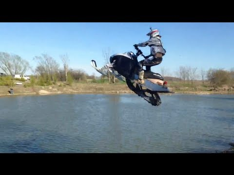 Snowmobile Pond Jump Fail!