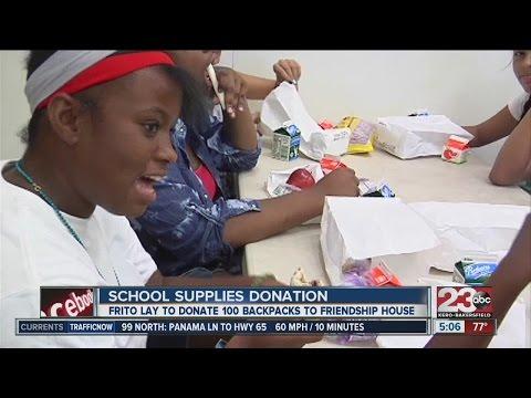 Frito Lay donates 100 backpacks to Friendship House - 07/25/2014