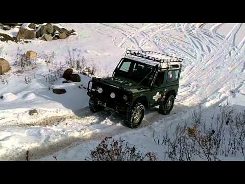 OEX Defender 90 Climing a hill in 1' of snow.