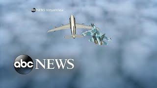 Russian fighter jet flies within feet of a US Air Force reconnaissance plane