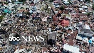 Indonesia quake and tsunami: At least 800 dead
