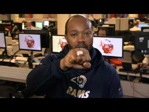 Torry Holt shows off his NFL Super Bowl ring to BBC World News