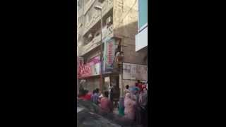 Sex workers fleeing after FIA raid at a brothel in Karachi