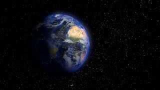 Beautiful planet earth rotating backwards into night HD