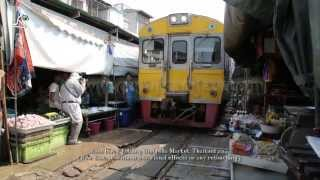train goes through market in thailand / Funny Rom Hub Market, Folding Umbrella Market