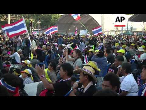 Opponents of prime minister protest next to Democracy monument