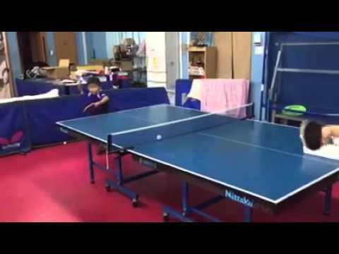 Power play, kid table tennis player...