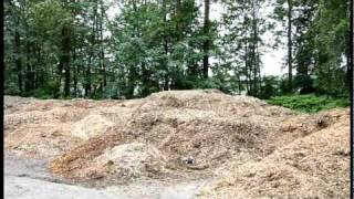 Brushless E Revo, Rustler RC Jumping at Wood Chip Pile