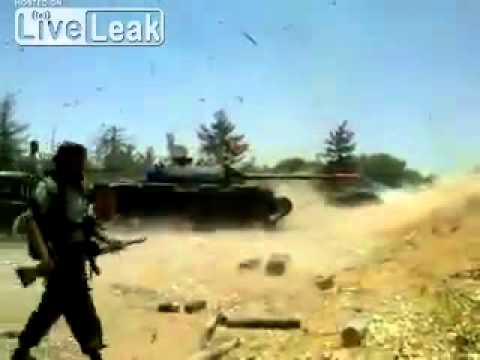 T-72 Tank Explodes during firing shells on Gaddafi's army ( Cooling system failure )