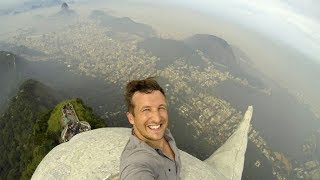 See how Lee Thompson climbed to the top of Christ the Redeemer statue in Rio to take a selfie!