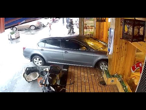 Car Runs into Restaurant in Shanghai