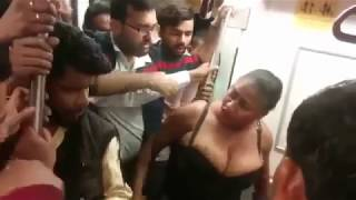 Fight in metro with African lady Remove her cloths