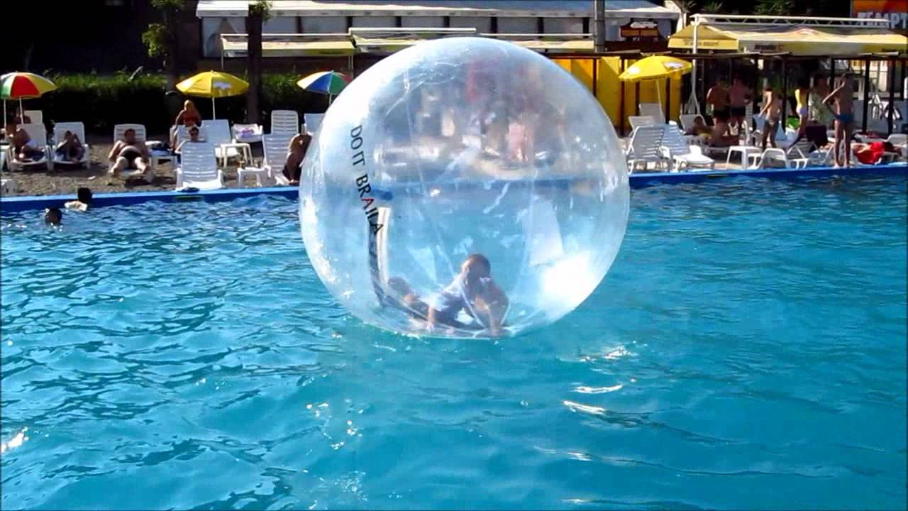 crazy kid in the water walking ball at summer club