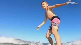Watch: Florida boy gets knocked off surfboard by shark