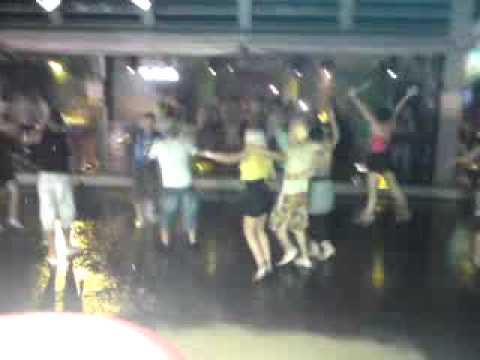 People Dancing In The Rain In