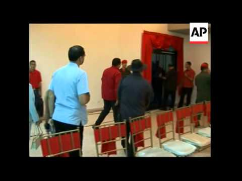 WRAP Chavez meets relatives of FARC hostages ADDS more