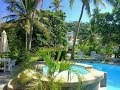 Puerto Galera - Blue Crystal Beach Resort on a tropical island.