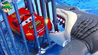 Disney cars are in the pool. Scary sharks come! Disney car is stuck in cage.
