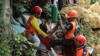 At least 29 dead in Philippines landslide