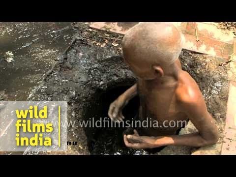 Pathetic sad old Indian man has to clean drains for a living
