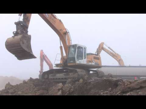 Liebherr Loading Trucks And Breaking Loose Frozen Ground
