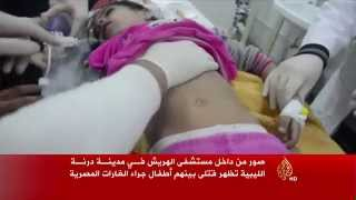 صور من داخل مستشفى الهريش تظهر قتلى بينهم أطفال جراء القصف المصري على درنة