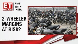 Nikunj Sanghi of FADA & Mayur Milak, Research Analyst on major two-wheeler companies slashing out