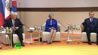 May sat between Trump and Erdogan at G20 summit