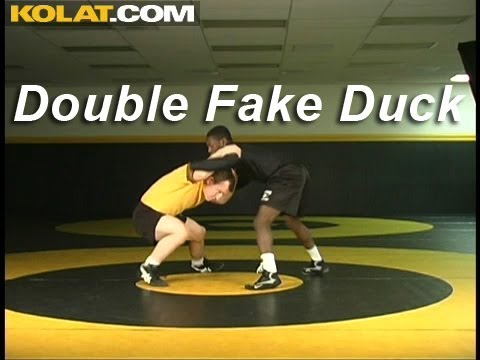 Double Fake Duck Under KOLAT.COM Wrestling Techniques Moves Instruction Image 1