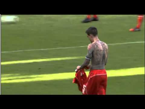 Daniel Agger throws his shirt into the Brondby crowd at half time 16/07/14