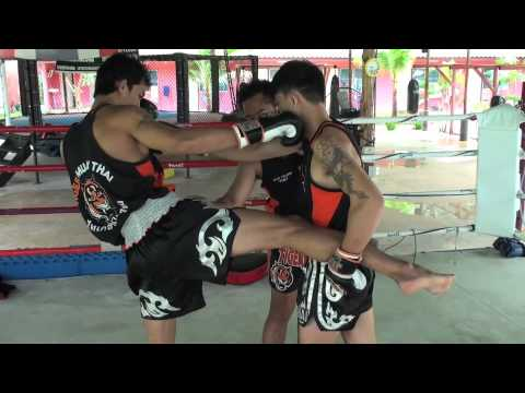 Tiger Muay Thai Techniques: Right body kick followed by right hook to the face Image 1