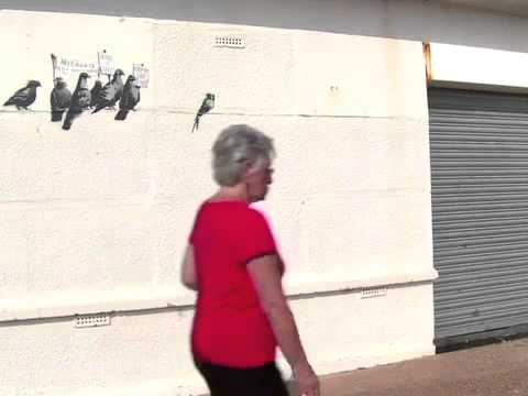 Oops uk council destroys banksy immigration mural for Banksy mural painted over