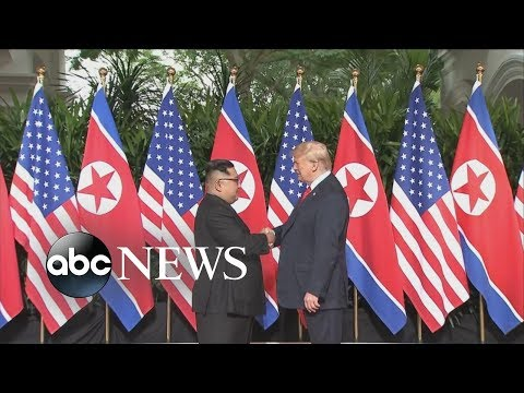 Kim Jong Un, Trump shake hands for the first time
