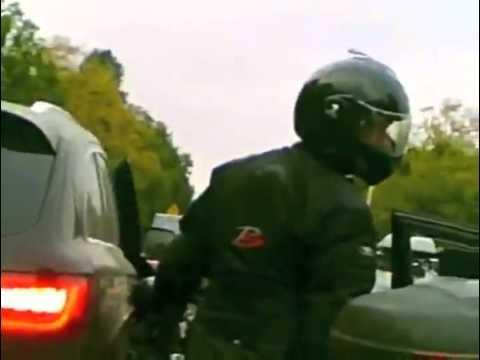 Driver Opens Door On Biker