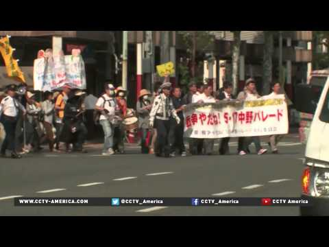 Tokyo demonstrations oppose changes to military