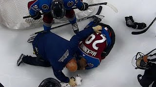 MacKinnon gets stick right in the eye against Ducks