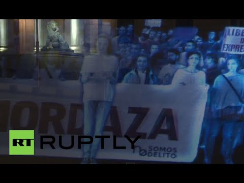 Spain: See world's first HOLOGRAM protest against gag law