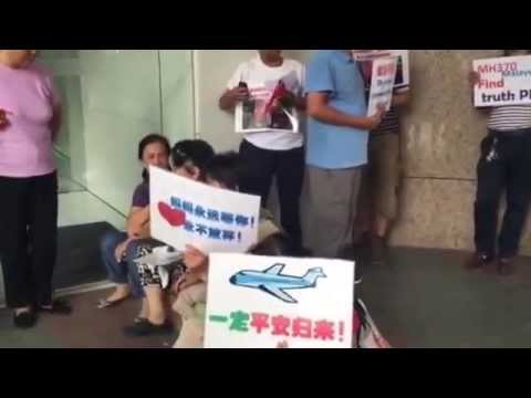 Relatives gather outside Malaysia Airlines office in Beijing, China
