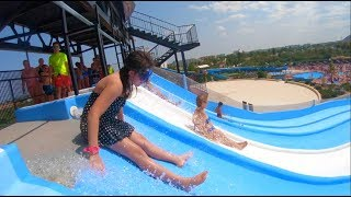 Kids Playing at the Water Park Family Fun Playtime in the Pool with Slides