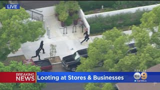 LAPD Officers Foot Chase After Looting In Hollywood