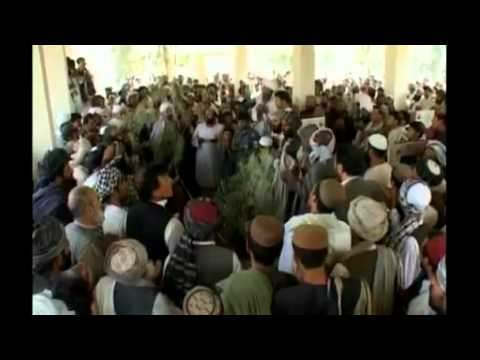 Afghan president buries slain brother