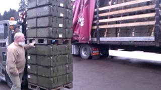 Military surplus army ammo boxes being loaded