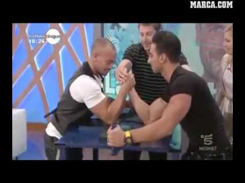 Guy breaks his arm while arm wrestling on TV