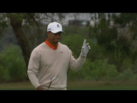 In the opening round of the 2013 Farmers Insurance Open, Tiger Woods holes a 39-foot eagle bunker shot on the par-5 6th hole.