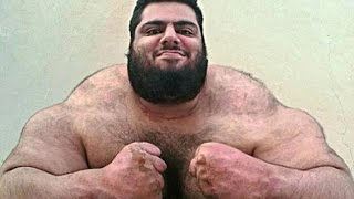 The incredible Iranian 'Hulk' who is 24 stone of near solid muscle goes topless with small objects