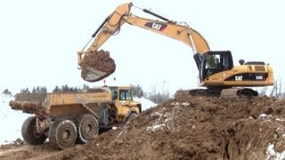Loading Volvo A25 Dumper's With The Cat 325D