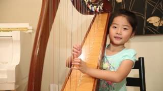 Ella He practice harp after 2nd class