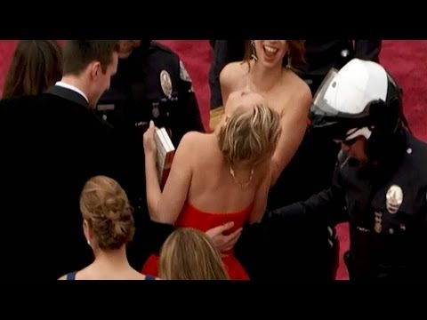 Jennifer Lawrence FALLS on Oscars Red Carpet 2014!